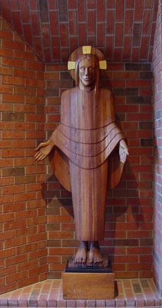 Glorified and Risen Christ statue in laminated walnut.