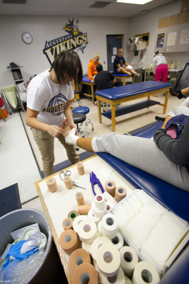 Athletic training student wraps an ankle