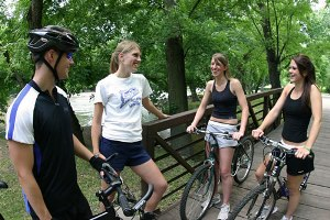Students riding bicycles in Sioux Falls, home of Augustana University.