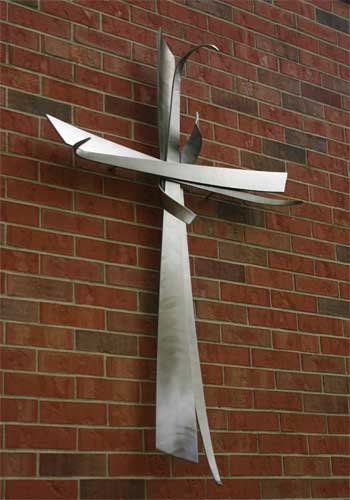 Cross by Dale Claude Lamphere, west exterior wall of the Chapel of Reconciliation