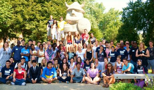 International students near Augustana's Ole statue