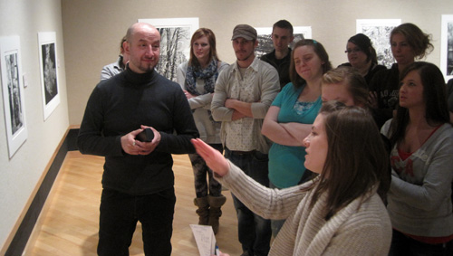 Michael Goro meets with art majors in the gallery