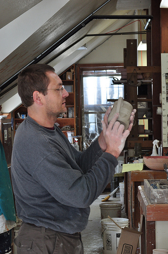 Dave Greenlund works on a ceramic cup
