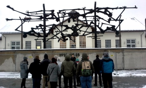 The group takes in the haunting history at Dachau.
